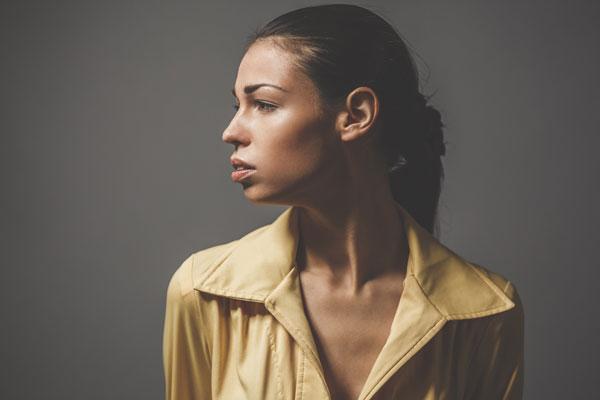 : A girl facing signs of hearing loss
